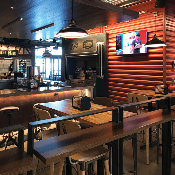 The first-floor bar is equipped with pendant speakers, a subwoofer and a 4K display for music, TV programs and digital signage.