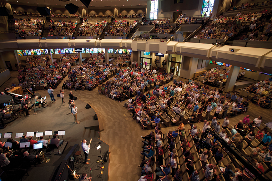 Each of the five sections of main floor seating is covered by a speaker. Extensive acoustic treatment, some of which is visible along the front of the balcony, was used to make the sanctuary more suitable for live sound.