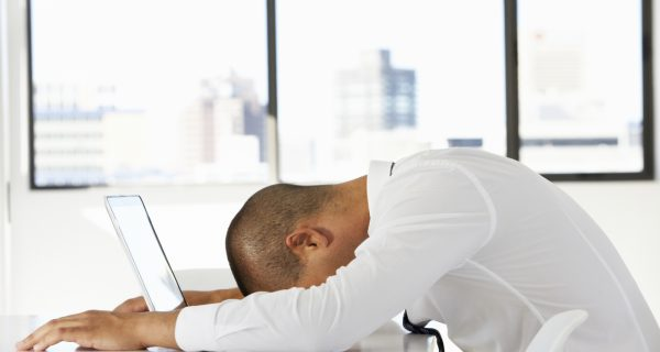 AVIXA POV, Man with head on computer