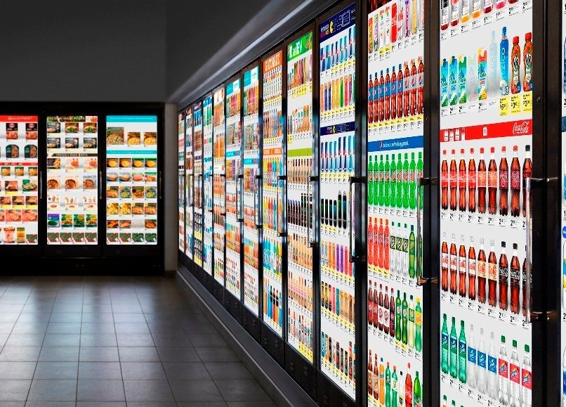 convenience store with digital displays on refrigerator doors
