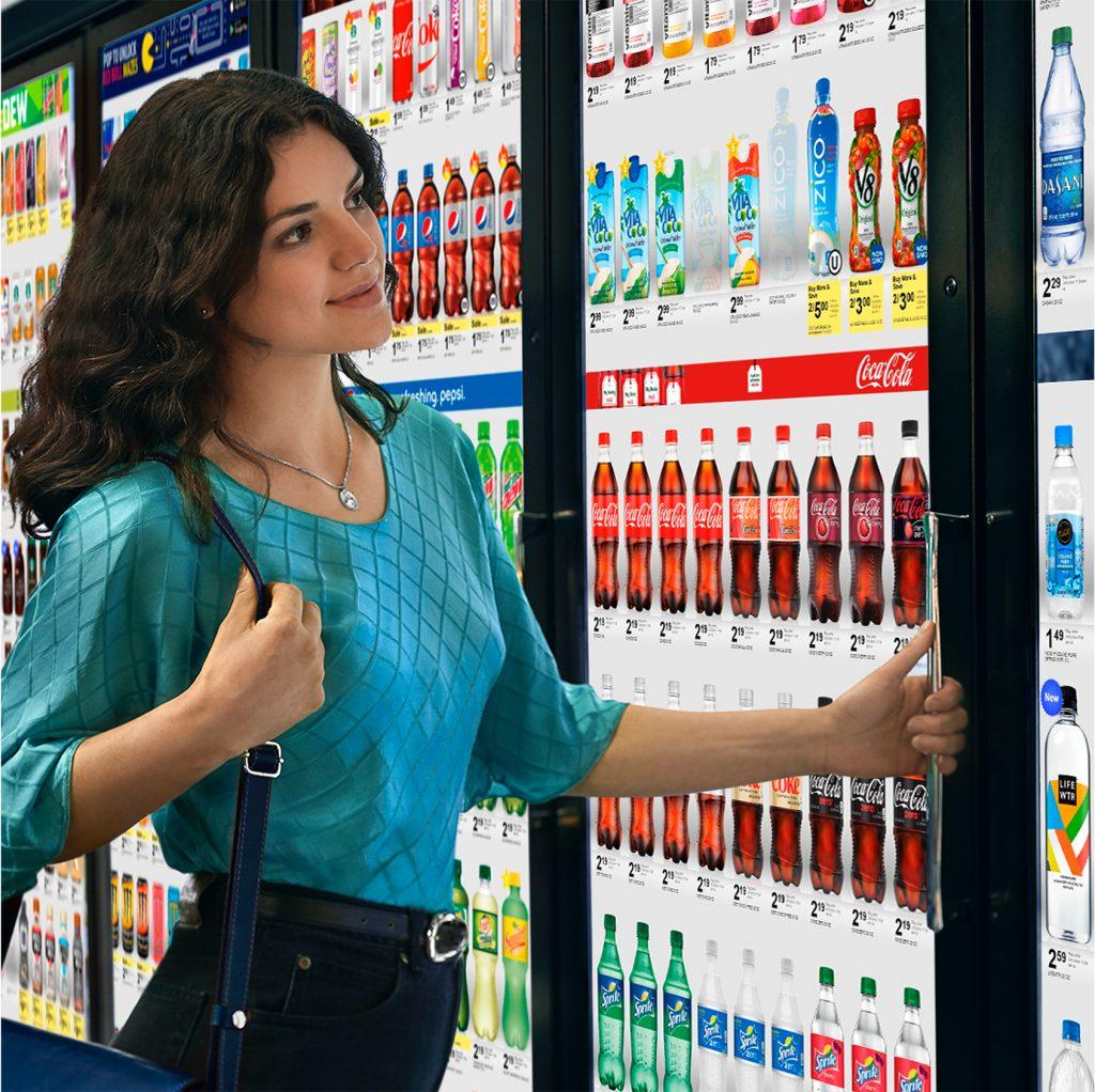 woman viewing drinks on digital refrigerator screen