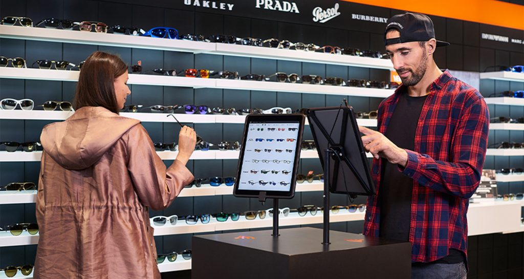two people using ipads integrated into a retail store