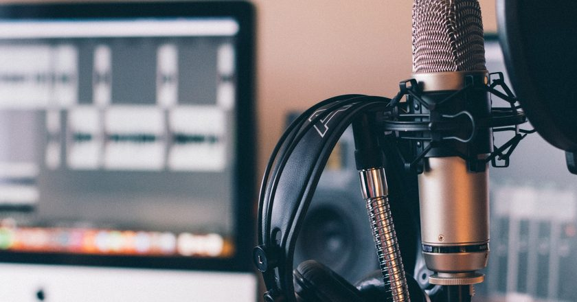 condenser microphone and headphones in a music studio