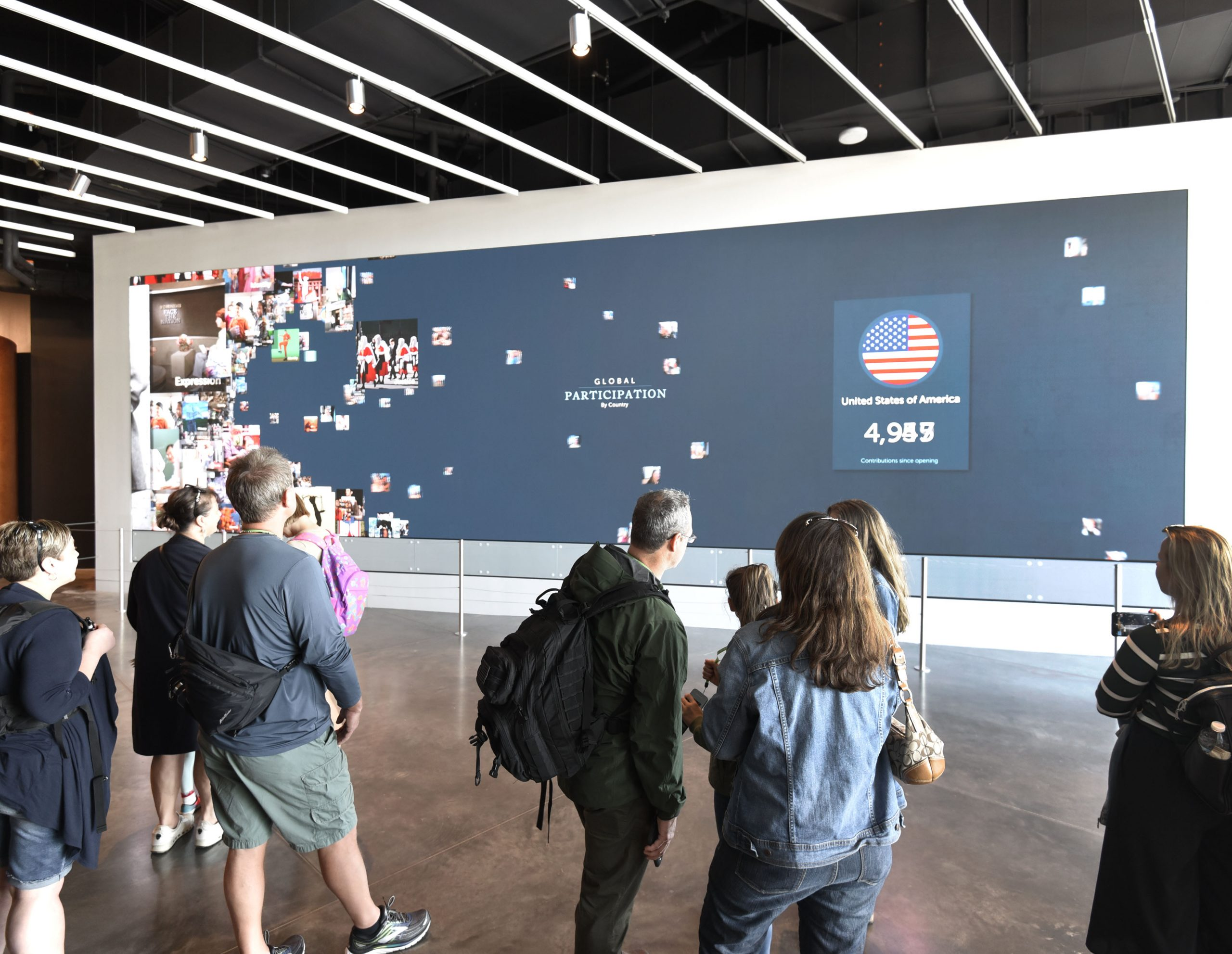 large interactive videowall being viewed by a crowd
